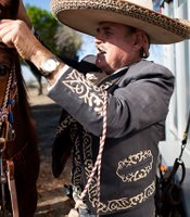 Filemon Jara Sr. of San Ysidro gets his horse ready for a Sunday charreada. Pico Rivera, CA.