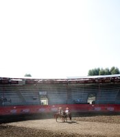 The charros gather in the arena before the competition begins.