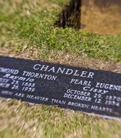 The new grave marker for the Chandler gravesite. It includes the names of both Raymond and Cissy, along with the line from the Chandler-penned novel &quot;The Big Sleep&quot;: &quot;Dead men are heavier than broken hearts.&quot; 