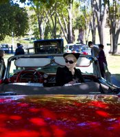 A parade of classic, antique cars drove Cissy Chandler&#39;s ashes from the Mausoleum to the Chandler grave.