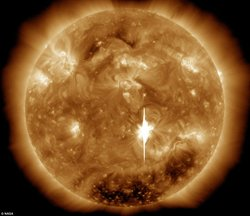 Erupting from active region AR1158 in the sun's southern hemisphere, the flare was captured in extreme ultraviolet image by Nasa's Solar Dynamics Observatory (SDO). The intense burst of electromagnetic radiation above a 60,000 mile-wide dark sunspot momentarily overwhelmed pixels in SDO's detectors, causing the bright vertical blemish.
