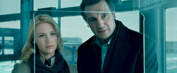 "January Jones and Liam Neeson as a married couple in Berlin for a conference in ""Unknown."""