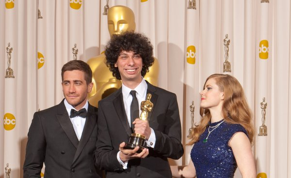Jake Gyllenhaal and Amy Adams flank Best Live Action Short winner Luke Matheny.