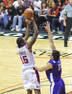 Aztecs forward Kawhi Leonard shoots a jump shot against TCU.