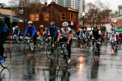 Local cyclists riding on a rainy day in Little Italy.