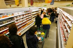 People shop in the meat aisle at a Fresh & Easy grocery store in Los Angeles, California.