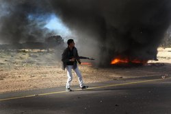 A rebel fighter advances on the front line against Libyan government forces on March 2, 2011 in al-Brega, Libya. 