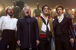 "Alfie Boe, Colm Wilkinson, Ramin Karimloo and Nick Jonas perform on stage together for the ""Les Miserables 25th Anniversary Concert At The O2."""