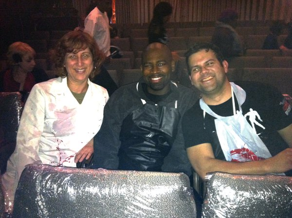 "Beth Accomando, Sanns Dixon, and Phil Lorenzo sitting in the ""Splash zone"" for ""Re-Animator: The Musical."""