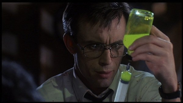 "Jeffrey Combs as Herbert West in the 1985 film ""Re-Animator."""