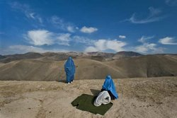 Lynsey Addario photographs women walking the hilly terrain in Afghanistan.