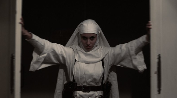 "Asun Ortega as Sister Sarah in ""Nude Nuns with Big Guns."""