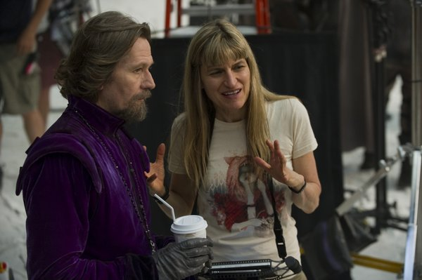 "Director Catherine Hardwicke with Gary Oldman in ""Red Riding Hood."""