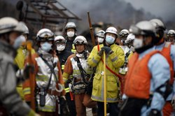 In this handout images provided by the International Federation of Red Cross Japan, civil defense teams search for survivors March 15, 2011 in Otsuchi, Japan. After a third explosion Tuesday at the Fukushima Daiichi nuclear power plant, the government is telling people living within 20 miles to stay indoors with the windows closed because of the possibility of high levels of radiation being released from the plant.