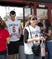 Enthusiastic fans gathered to watch the Aztecs game. The game was shown on the Jumbotron in Viejas Arena. The screening was free.