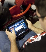 This fan was monitoring his NCAA bracket during the game.