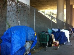 Makeshift homeless shelters line Commercial St. in downtown San Diego.