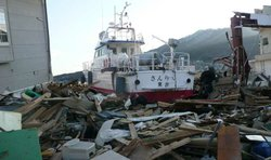 Police boat in debris in Ofunato, Japan.