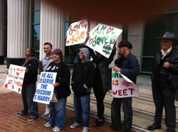 Members of Canvass for a Cause demonstrate outside the San Diego Courthouse after their attorney appeared in court to respond to a lawsuit brought by Target Corporation, March 25, 2011.