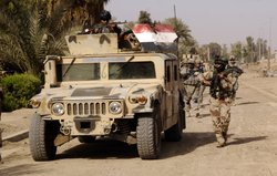 U.S. and Iraqi Soldiers conduct a patrol in Amariyah, Iraq, May, 2008.