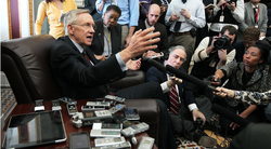 U.S. Senate Majority Leader Sen. Harry Reid (D-NV) speaks to members of the press during a news briefing on Capitol Hill on Friday.