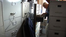 Bill amid his file cabinets in his apartment above Carnegie Hall.