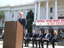 Gov. Jerry Brown speaks at a rally for crime victims and their families at the State Capitol Monday.