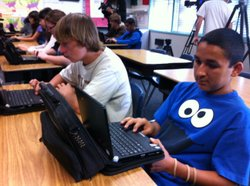 Dillon Stanton, 14 (left), and Richard Gonzalez, 14, use their netbooks in Rick Selby&#39;s eighth grade United States History class on April, 13, 2010.