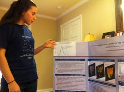 La Jolla High School Junior Meredith Lehman, 15, explains a graph that shows the peak and duration of the 1918 Influenza Pandemic, April 13, 2011.