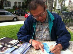 Latino political activist Mateo Camarillo draws a map on the day's newspaper during an interview about redistricting in San Diego.