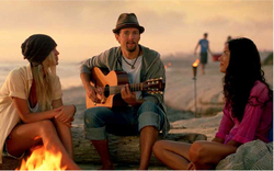 Musician Jason Mraz appears in a television commercial promoting travel to California. He's posing in front of a San Diego fire pit.