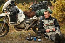 Adventurer and bear biologist Chris Morgan takes a break after an exhausting drive on the way to Anchorage from Homer along a back road.