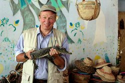 Richard Bangs holds a baby crocodile liberated from a cage in a Nubian village on the Nile River in Egypt.