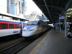 High-speed trains around the world are pulling into stations like this one in South Korea. And two researchers say building a system for California will reduce greenhouse gas emissions. 