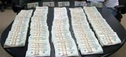 Cash seized from the drug trafficking organization led by Roberto Hernandez.