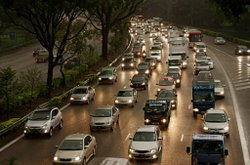 An increase in vehicles miles traveled is a sure sign of an improving economy, but also more traffic jams and greenhouse emissions.