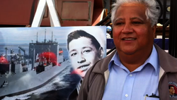 Paul Chavez stands in front of a picture of his father, Cesar. The newest cargo ship being built at NAASCO will be named the USNS Cesar Chavez after the late civil rights leader.