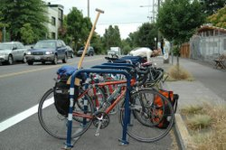 Lots of cities, including San Diego, are installing bike corrals for cycling commuters. 