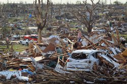 Maddie Meek,9, and her mother Dina Meek salvage what they can from her sister-in-law's home after it was destroyed when massive tornado passed through the town killing at least 116 people on May 24, 2011 in Joplin, Missouri.