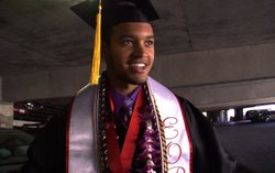 Anthony Porter, 24, finishes putting on his graduation robe, mortarboard and honors cords in the parking lot just before commencement, May 21, 2011