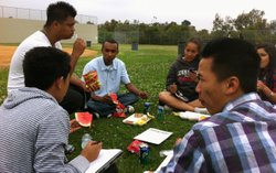 Idris Ahmed (center), 18, sits with his friends during the Crawford Invention and Design Educational Academy senior barbecue, June 10, 2011.