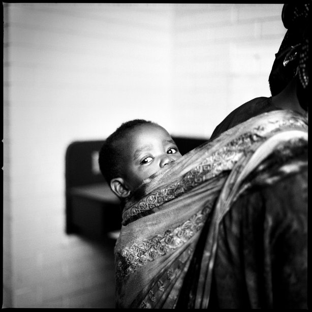 Somali Bantu child on his mother's back