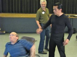 Dance instructor William Valencia shows Isaac Whiting how to execute a turn. Valencia figures he's taught about 250 wheelchair dancers since he started his first class in 2009.