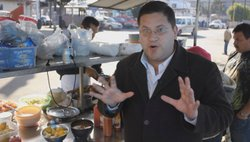 Host Jorge Meraz eating tacos from a street vendor, Tijuana. 