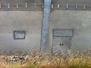 The secondary fence made of meshed steel at the Tijuana-San Ysidro border, gets patched up on a regular basis despite the increase in security.