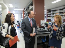 Dr. Roberta Gottlieb (right), director of San Diego State's BioScience Center, explains the building's laboratory facilities to Dr. Elliot Hirshman and his wife Jeri on Hirshman's first day as San Diego State University president, July 5, 2011.