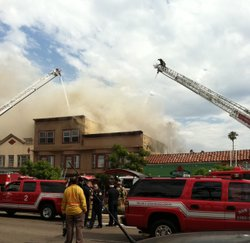 Hillcrest fire above Obelisk bookstore.