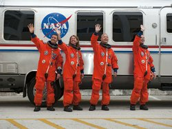 The four STS-135 astronauts wave to media and employees cheering them on in front of the Astronaut Crew Quarters in the Operations and Checkout Building at NASA's Kennedy Space Center in Florida. From left, are STS-135 Mission Specialists Rex Walheim and Sandy Magnus, Pilot Doug Hurley, and Commander Chris Ferguson.