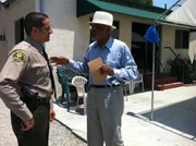 Deputy Sheriff Morsi meets with Imam Abdul Karim Hasan outside his mosque in South Central Los Angeles.