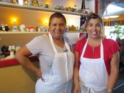 Melva Aguirre (left) owns the Pepper Pot Restaurant in Hatch, New Mexico. Her sister Rosario Varela also works there. The governor signed a bill protecting New Mexico chiles at the popular restaurant.